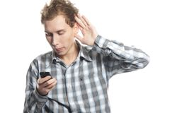 Young man with cell phone. Over white Royalty Free Stock Images