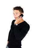 Young man with cell phone. Standing against white background Royalty Free Stock Photography