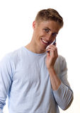 Young man with cell phone Stock Photography