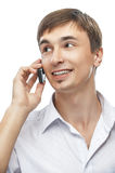 Young man with cell phone. Portrait of handsome young man with cell phone, isolated on white background Royalty Free Stock Photos