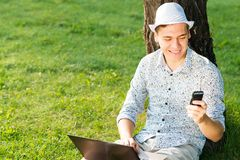 Young man with a cell phone Royalty Free Stock Photography