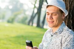 Young man with a cell phone Royalty Free Stock Images
