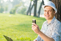Young man with a cell phone Stock Photo