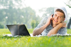 Young man with a cell phone Stock Photography