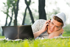 Young man with a cell phone Stock Photos