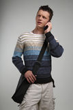 Young man on cellphone. Attractive young man on cellphone Stock Photo