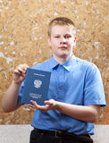 The young man with the certificate about completion of education at school Stock Image