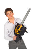 Young man with chainsaw Royalty Free Stock Image