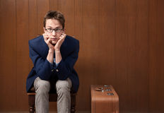 Young Man on Chair with Suitcase Stock Images