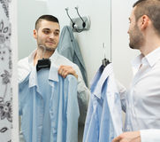 Young man at changing cubicle Stock Image