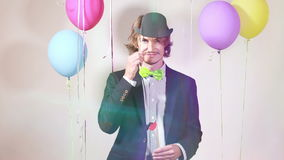 Young man changing props in photo booth stock footage