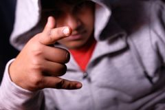 Young man with characteristic heavy metal hand gesture Royalty Free Stock Images