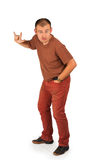 Young man with characteristic heavy metal hand gesture. On white background Royalty Free Stock Photography