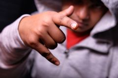 Young man with characteristic heavy metal hand gesture Royalty Free Stock Photos