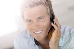 Young man in charge of customer service Royalty Free Stock Image