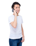 Young man chat on cellphone Stock Photo
