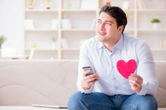 The young man chatting with his sweetheart over mobile phone. Young man chatting with his sweetheart over mobile phone royalty free stock photos