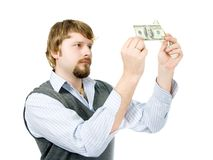 Young man checking dollars Royalty Free Stock Photography