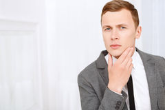 Young man checking his bristle hair on face Royalty Free Stock Image