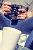 Young man checking his camera Stock Photography