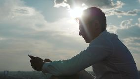 Young man checking his phone while waiting his flight in the airport - Business man at airport and airplane and airport. In the background stock footage