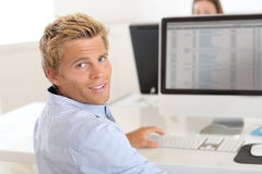 Young man checking results on computer Stock Image