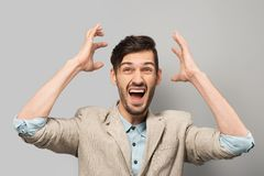 Young man cheerfully smiling Stock Photos
