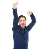 Young man cheering and celebrating with arms raised. Portrait of a young man cheering and celebrating with arms raised Stock Photos