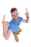 Young man cheering. Top view of a casual young man cheering with his fingers raised . on a white background Stock Photography