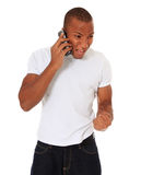 Young man cheers during phone call Royalty Free Stock Photography