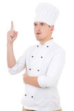 Young man chef showing idea sign isolated over white Stock Images