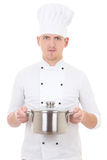 Young man in chef uniform with saucepan isolated on white Stock Image
