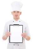 Young man in chef uniform showing clipboard with blank paper iso Royalty Free Stock Photo