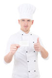 Young man chef  in uniform thumbs up and showing blank visiting Royalty Free Stock Photo