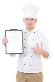 Young man in chef uniform thumbs up and showing clipboard with c Royalty Free Stock Images