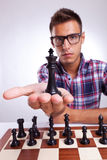 Young man chess player holding up his king Stock Photo