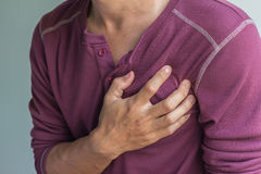 Young man with chest pain royalty free stock photography