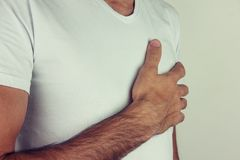 Young man chest pain or heart attack on white backgrou.  stock photo
