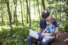 Young man and child worship. A young men and child read bible in nature. Family faith stock images