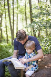 Young man and child worship. A young men and child read bible in nature. Family faith stock photography