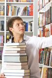 Young man choosing books Stock Photo