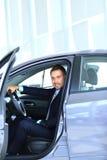 Young man choosing car Royalty Free Stock Photos