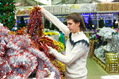 Young man choosing decorations on the Christmas Stock Photography