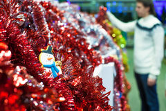 Young man choosing decorations on the Christmas Royalty Free Stock Images