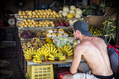 Young man choosing fruits Stock Images