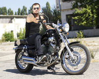 Young man on a chopper. Motorcycle royalty free stock photography