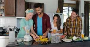 Young Man Chopping Pineapple, Woman Put It In Blender People Group Talking Prepare Healthy Smoothie Two Couples In stock video