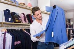 Young man chousing jacket Stock Photos