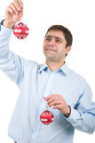 Young man with christmas balls Royalty Free Stock Photos