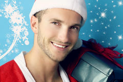 Young man with a Christmas gift Royalty Free Stock Photo